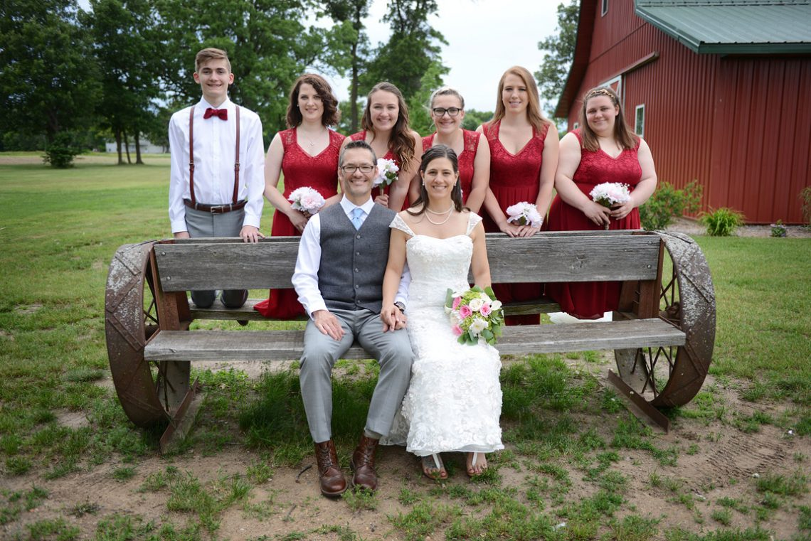 Weddings S&T wedding party on bench