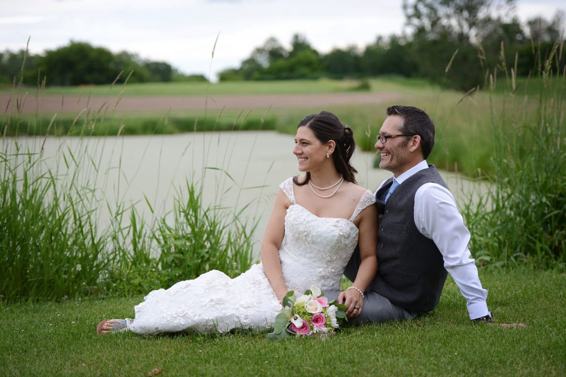 Weddings S&T sitting by pond