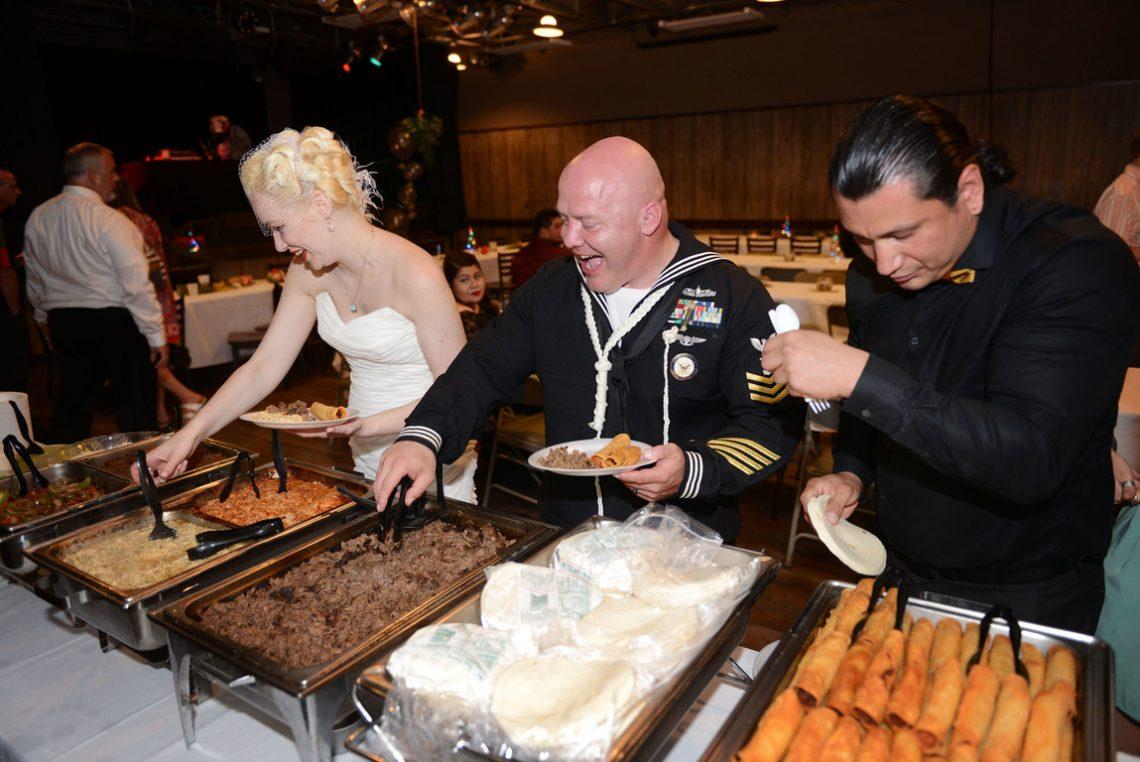 Wedding bride and groom getting food