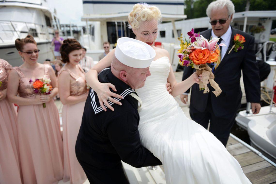 Wedding bride being carried by groom