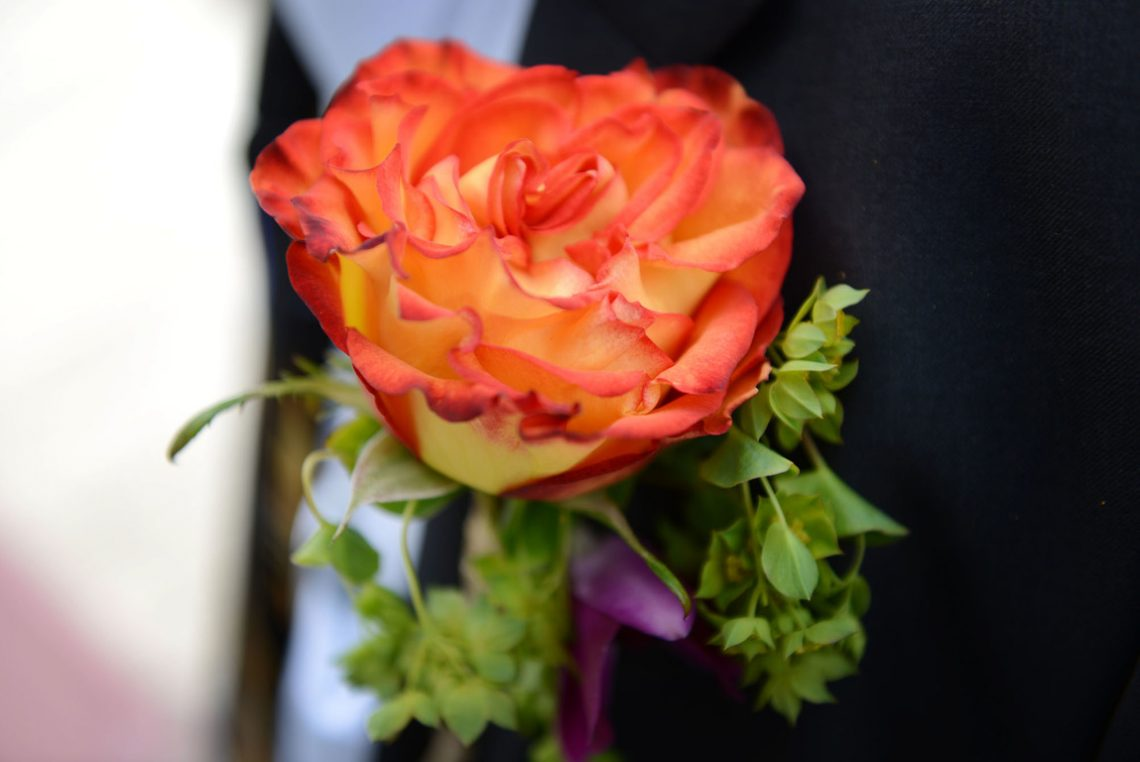 Wedding detail coral boutonniere