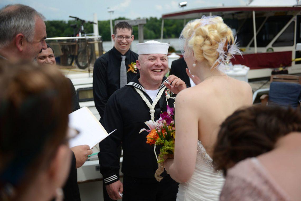 Wedding groom laughing