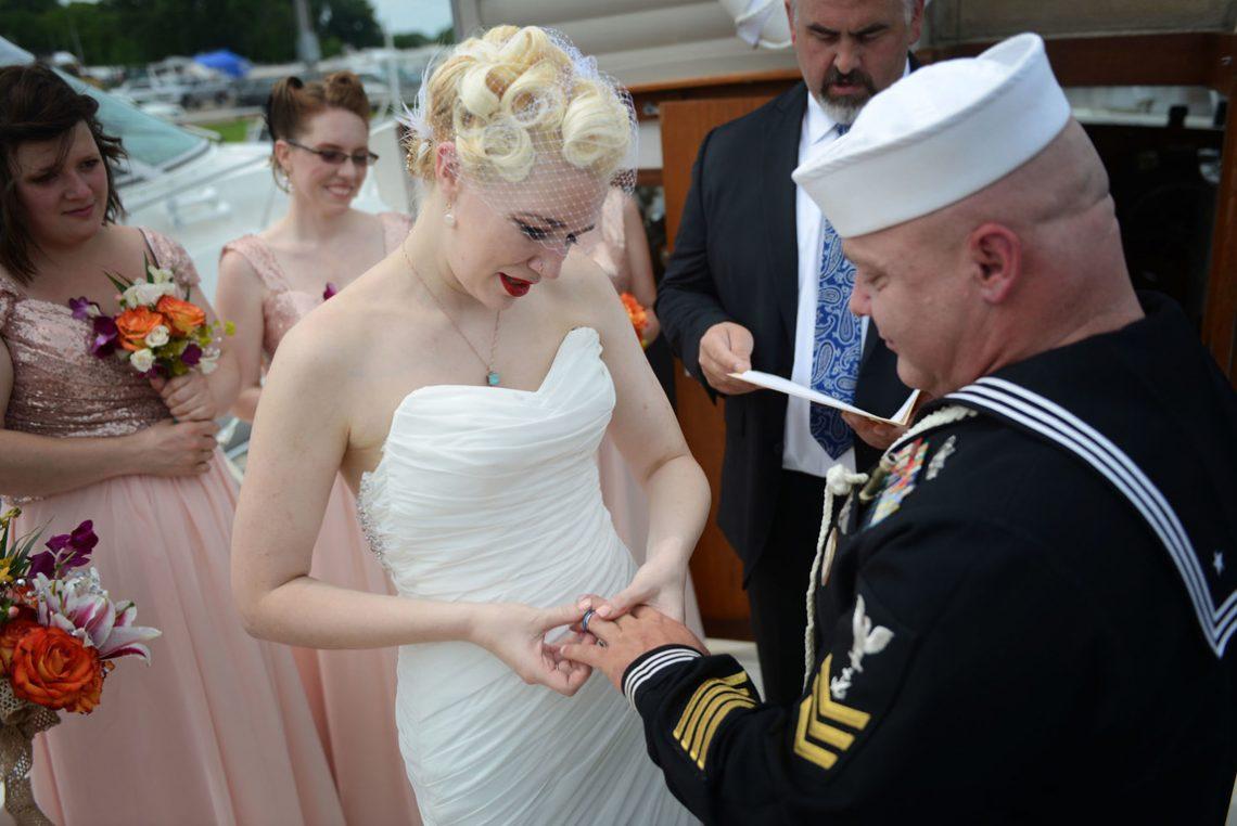 Wedding groom receiving ring