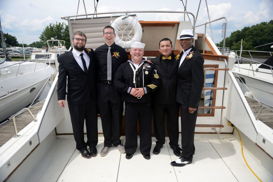Wedding groomsmen on boat
