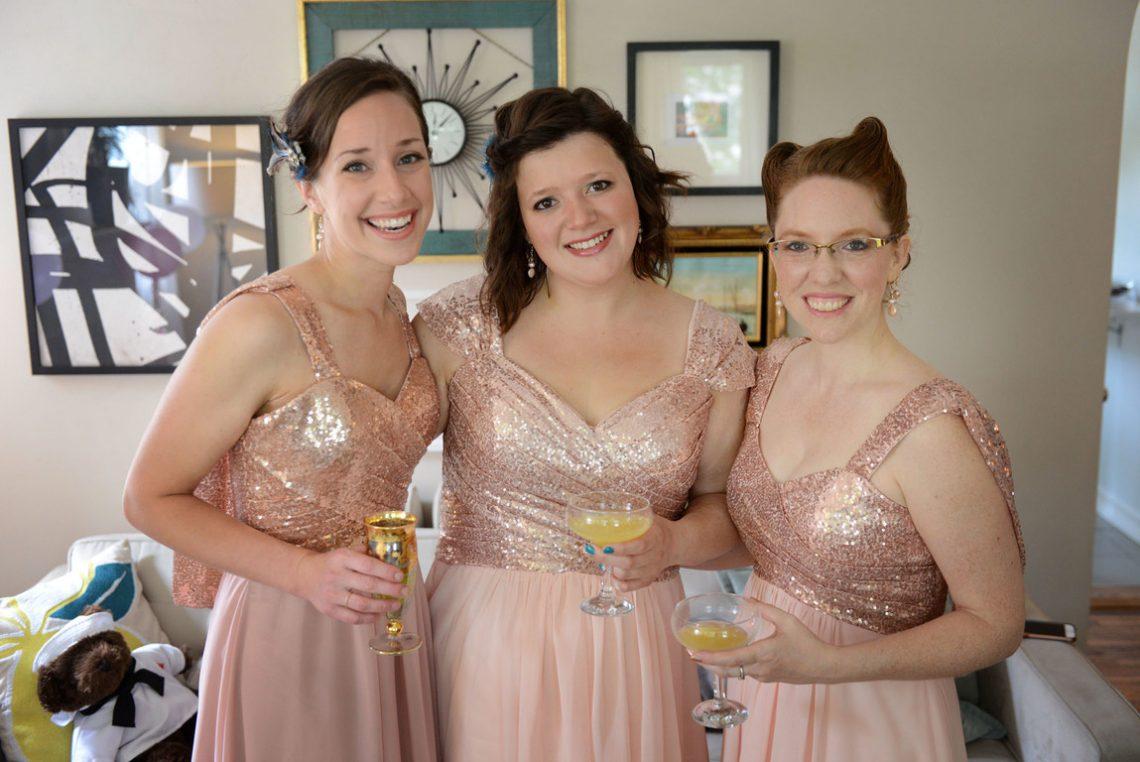 Wedding prep bridesmaids with drinks