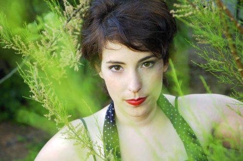 Portrait of Melanie in green