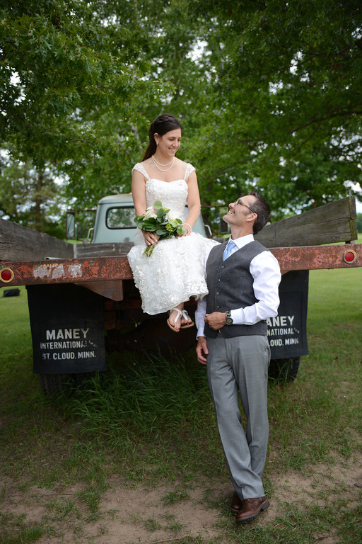Weddings S&T Shira on truck with Tracy looking up